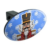 Grinning Nutcracker Soldier with Snowflakes Oval Tow Trailer Hitch Cover Plug Insert