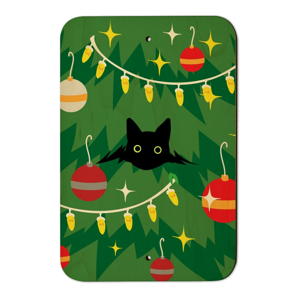 black cat hiding in christmas tree home business